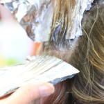 A close-up picture of a woman receiving highlights